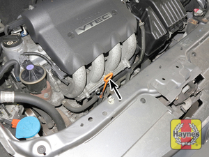 Illustration of step:  2 The engine oil level is checked with a dipstick located at the front of the engine  - step 3