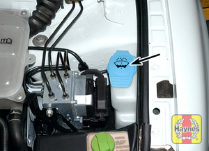 Illustration of step: 2 Flip open the cap (arrow) to check the fluid level in the tank  - Windshield washer fluid - step 22