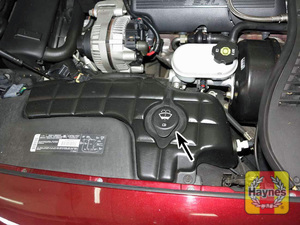Illustration of step: 24 Fluid for the windshield washer system is stored in a plastic reservoir located at the left rear of the engine compartment  - Windshield washer fluid - step 32
