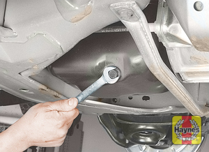 Illustration of step: Using a wrench or socket, carefully remove the drain plug and fully drain the oil - step 3