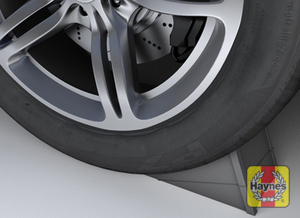 Illustration of step: Try to use a wheel chock on the wheel diagonally opposite the one being replaced  - step 1