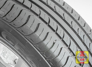 Illustration of step: Before installing the wheels, take a look at the tire tread; there should be a minimum of 1/16 inch remaining tread depth - step 14