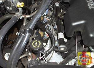 Illustration of step: Locate the oil filler cap and turn it counterclockwise - step 5