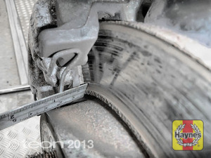 Illustration of step: Using a ruler, measure the approximate thickness of the remaining wear material on the brake pad - step 12