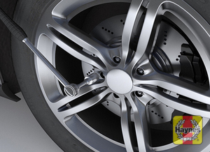 Illustration of step: If you intend to remove a wheel, always loosen the wheel lug nuts BEFORE you jack the car  - step 2