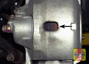 Illustration of step: Virtually all cars have this inspection window in the brake caliper body, you can usually see the brake pad thickness from here  - step 7