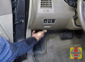 Illustration of step: To open the hood pull this lever in the driver's footwell - step 1