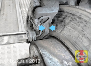 Illustration of step: If your car has disc brakes, locate the rear brake pads - step 13