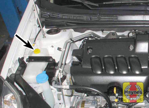 Illustration of step: The coolant reservoir is located here  - step 1