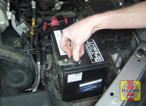 Illustration of step: Check the battery is generally secure, and if loose, tighten the battery retainer  - step 4