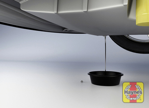 Illustration of step: Using a wrench or socket, carefully remove the drain plug and fully drain the oil - step 1