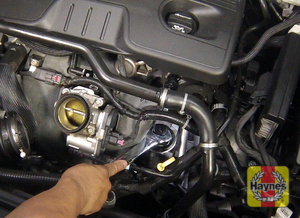 Illustration of step: Unscrew the oil filter cap (using a large socket, not an open-end wrench) - step 2