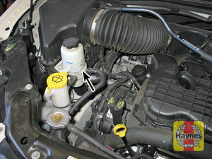 Illustration of step:  24 The power steering reservoir is located in the right side of the engine compartment  - Power steering fluid - step 30
