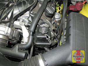 Illustration of step:  2 The power steering fluid reservoir is located at the left front corner of the engine - Power steering fluid - step 39
