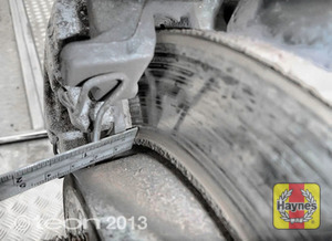 Illustration of step: Using a ruler, measure the approximate thickness of the remaining wear material on the brake pad - step 14