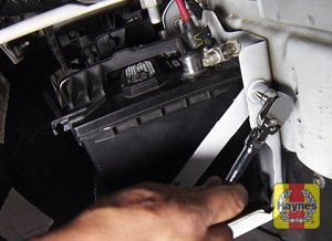 Illustration of step: Check the battery is generally secure, and if loose, tighten the battery retainer  - step 3