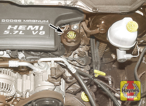 Illustration of step:  6 To add oil, remove the filler cap from the valve cover (arrowed)  - step 6
