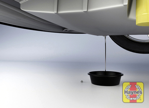 Illustration of step: With an oil drain pan in position, using a wrench or socket, carefully remove the drain plug and fully drain the oil - step 2