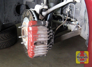 Illustration of step: Now quickly check all the brake lines, check for any leaks, also inspect the driveaxle boots for loose clamps, cracks or signs of leaking lubricant - step 8