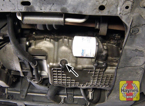 Illustration of step: The oil drain plug is located on the base of the engine, it is accessed underneath the car - step 1