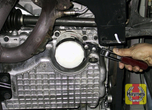 Illustration of step: Unscrew the oil filter cap (using a standard oil filter remover) - step 2