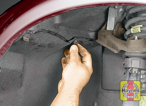 Illustration of step: Undo the splashshield in the front wheelwell - step 1