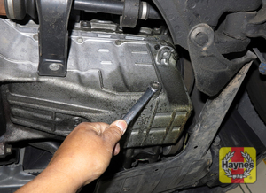Illustration of step: With an oil drain pan in position, using a wrench or socket, carefully remove the drain plug and fully drain the oil - step 3