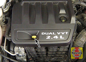 Illustration of step:  2 Engine oil level is checked with a dipstick that is located on the side of the engine facing the front of the vehicle - step 4