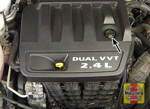 Illustration of step:  5 Oil is added to the engine after removing a cap located on the valve cover - step 7