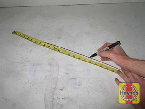 Illustration of step:  38a Using a standard non-painted coat hanger, straighten out the hanger then measure 16-11/16 inches from the tip  - 62TE (6-speed) models - step 51