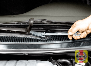 Illustration of step: 4 On convertible and sedan models, lift the cover and check the mounting nut for tightness  - step 4