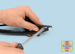 Illustration of step:  10 Insert a screwdriver blade between the wiper blade and element - Rear wiper blade replacement - step 13