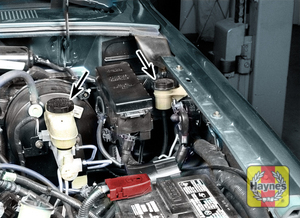 Illustration of step:  3 Clutch fluid is contained in a separate reservoir (right arrow) next to the brake master cylinder (left arrow) - clean the rubber-lined cap(s) before returning it to the reservoir  - Brake and clutch fluid - step 21