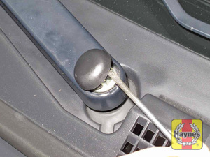 Illustration of step:  4 Gently pry off the trim cap and check the tightness of the wiper arm retaining nut  - step 4