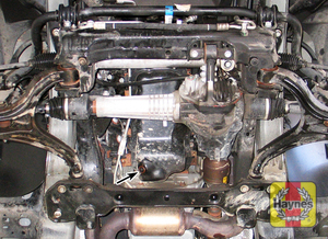Illustration of step: The oil drain plug is located on the base of the engine, it is accessed underneath the car - step 2