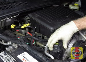 Illustration of step: Open the oil filler cap and use a funnel to avoid spillage  - step 4