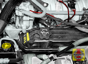 Illustration of step:  6 Oil is added to the engine after removing a cap from the valve cover - step 8