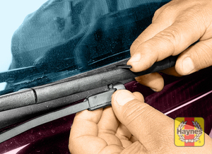 Illustration of step:  6 On early model rear wipers, lift the release lever and slide the blade assembly off the pin on the wiper arm and replace the assembly as a unit  - step 6