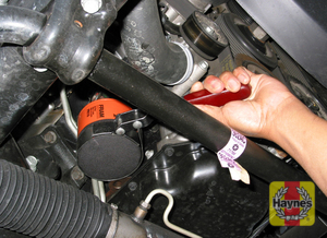 Illustration of step: Using an oil filter wrench, unscrew the filter counterclockwise and remove the old oil filter - step 2