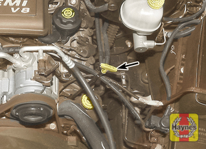 Illustration of step:  2 The oil level is checked with a dipstick, which is located on the side of the engine (arrowed)  - step 2