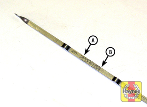 Illustration of step:  4 Pull the dipstick out of the tube and wipe all the oil from the end with a clean rag or paper towel - step 4