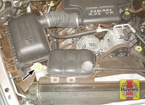 Illustration of step:  30 Fluid for the windshield washer system is stored in a plastic reservoir (arrowed) located at the right front of the engine compartment on 3 - Power steering fluid - step 35