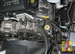 Illustration of step:  23 The power steering fluid reservoir (arrowed) is located on the left side of the engine (5 - Power steering fluid - step 28