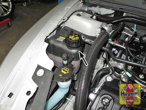 Illustration of step:  2 The cooling system expansion tank is located at the right side of the engine compartment  - Engine coolant - step 13