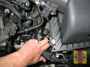 Illustration of step:  5 If the level is low, remove the filler tube cap (arrowed) and add the specified automatic transmission fluid through the filler tube with a funnel until the fluid starts to drip out of the oil leveling plug  - Four-cylinder models (6F35 transaxle) - step 61