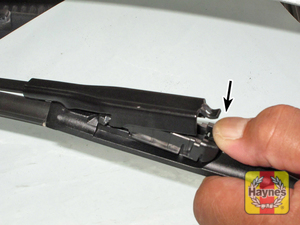 Illustration of step: 6a To release the blade holder, depress the locking tab downwards - step 6