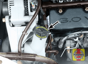 Illustration of step: The power steering fluid reservoir is located on the right side of the engine compartment - step 1